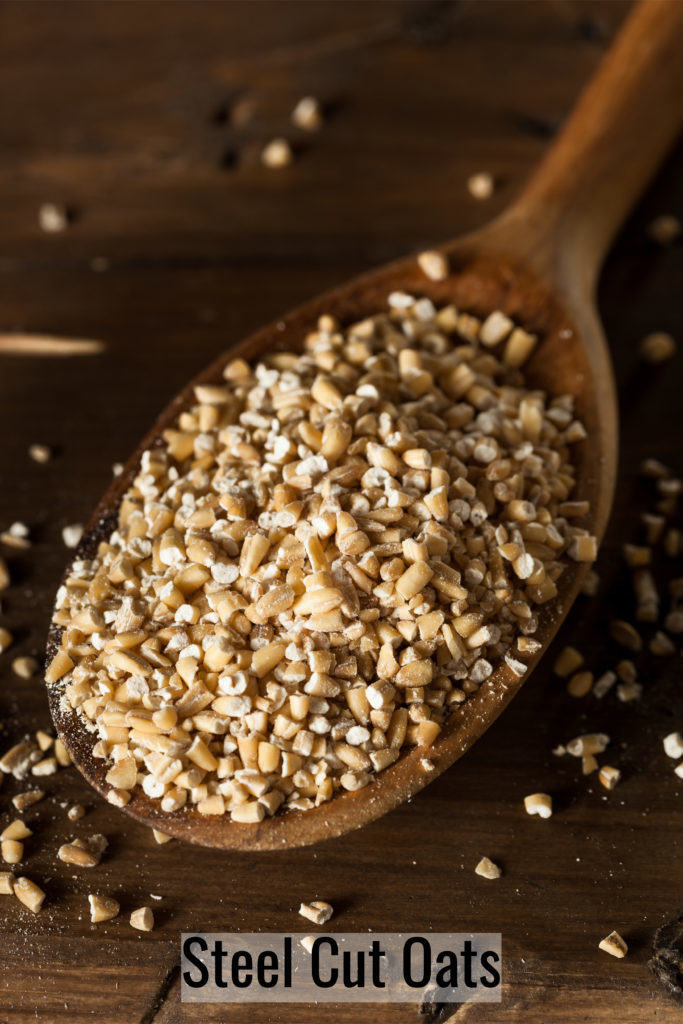 uncooked steel cut oats on a sppon to be used to make overnight steel cut oats recipe