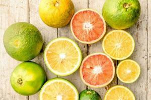 Collection of citrus fruits with some cut in half which may be consumed to help reduce stress.