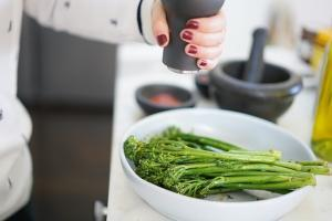 Bowl of broccolini, a food that relaxes muscles.