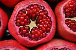Half sliced open pomegranates which are to be consumed as a stress reducing food.