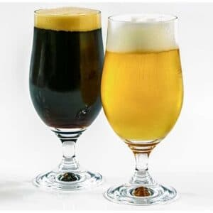 Two glasses of beer which contains alcohol and may contribute to leaky gut syndrome.