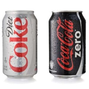 A can of diet Coke and Coca Cola Zero which are a leaky gut food to avoid due to artificial sweeteners